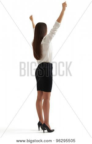 back view of happy winner businesswoman in formal wear raising her hands up. isolated on white background