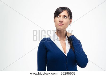 Portrait of a pensive businesswoman looking up isolated on a white background