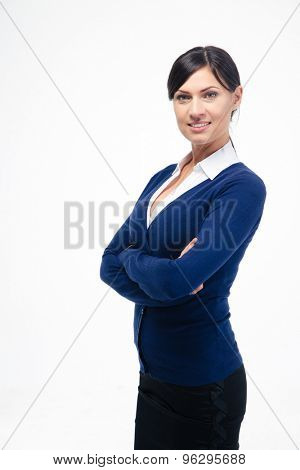 Portrait of a happy businesswoman standing with arms folded isolated on a white background. Looking at camera
