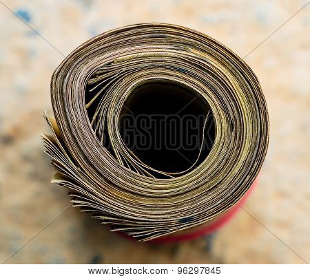 Financial management / Savings concept ~ Roll of Indian 500 rupees note currency papers