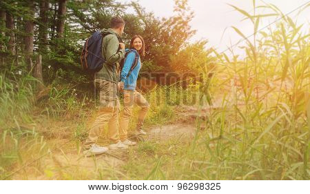 Hiker couple walking in the forest