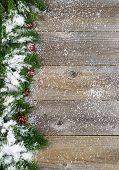 picture of snow border  - Christmas border with pine tree branches cones and snow on rustic wooden boards - JPG