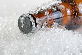 pic of condensation  - Close up view of a beer bottle neck covered with ice and condensation - JPG