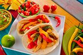 foto of poblano  - Chicken fajitas tacos mexican food guacamole pico de gallo chili peppes sauces - JPG