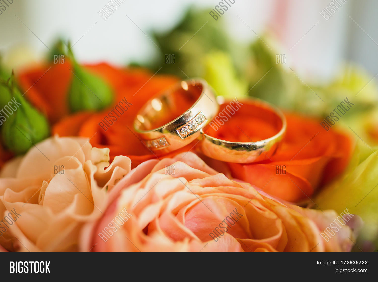 Wedding Rings On Red Wedding Flowers Background Wedding Bands