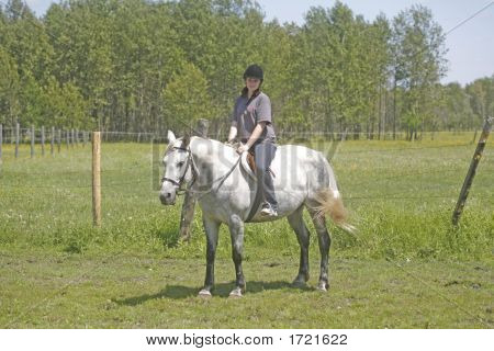 Melanie Riding Her Horse