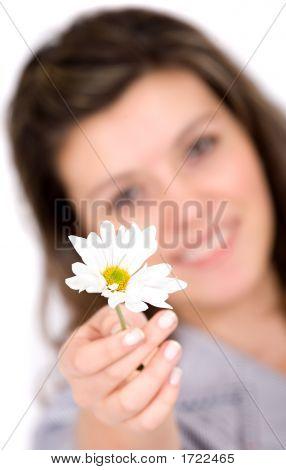 Girl Offering A White Flower