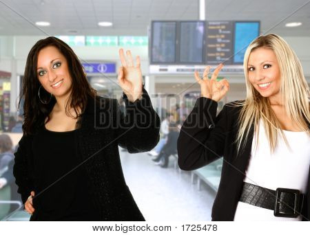 Two Attractive Travel Consultant With Airport Background