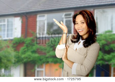 Attractive Housing Agent Showing A Property