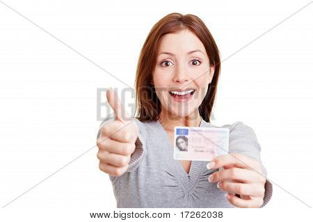 Woman With European Drivers License Holding Thumbs Up