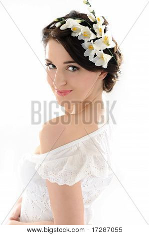Beautiful Spring Woman With Pure Skin And Flowers In Her Hair