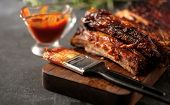 Delicious Barbecued Ribs Seasoned With A Spicy Basting Sauce poster