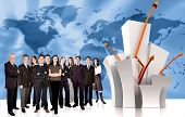 stock photo of business-partner  - businesspeople team next to a chart over a worldmap in the background - JPG