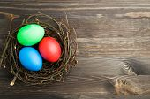 Easter Eggs On A Wooden Background .easter Eggs Of Different Colors .easter Eggs Top View poster