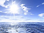stock photo of ozone layer  - brilliant sunshine over the ocean with lens flare. illustration of global warming and sunburn