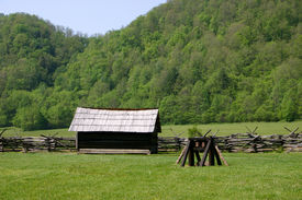 stock photo of smoky mountain  - Farm outbuildings found in a meadow located in Smoky Mountains National Park North Carolina - JPG