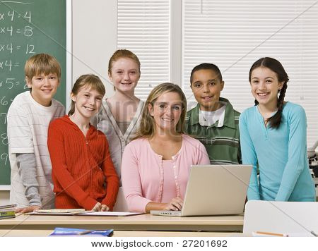 Teacher posing with students