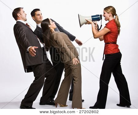 Businesswoman shouting with megaphone