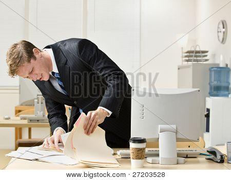 Businessman looking through file folders