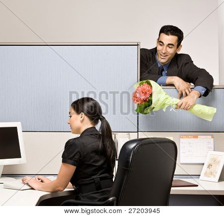 Businessman bringing co-worker flowers