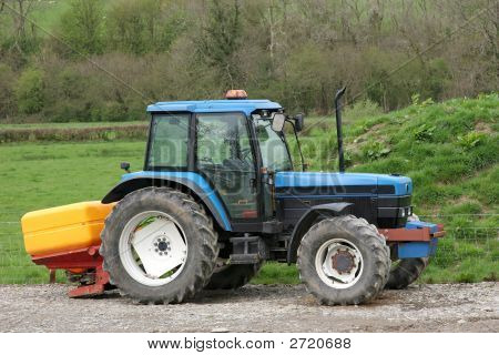 Tractor And Fertiliser Spreader