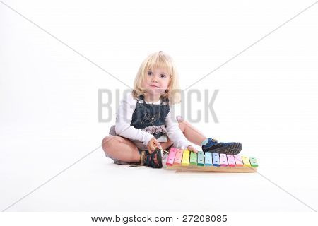 Girl Playing A Musical Toy