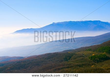 mountain landscape with fog in valley