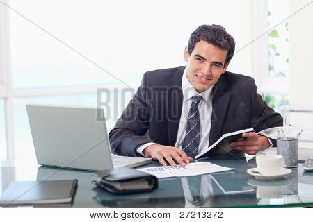 Young businessman working in his office