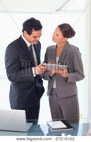 Young business partner working on tablet together