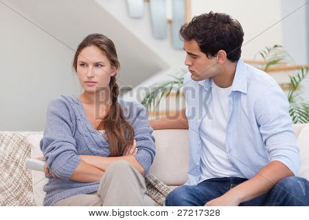 Woman being mad at her boyfriend in their living room