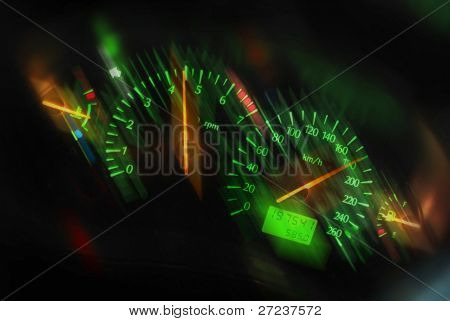 Speeding tachometer closeup of dashboard