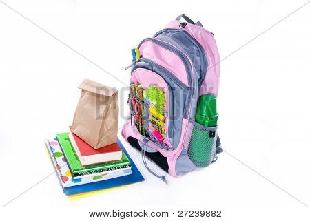 Elementary school student's book bag, books and lunch wait for the bus to show up