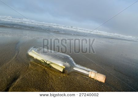 A bottle with a message inside of it washes ashore for a lucky person to discover.