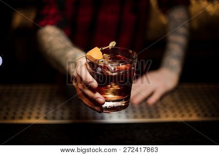 Professional Bartender Serving A Delicious