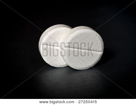 Two tablets on the black background