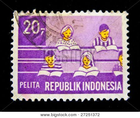 INDONESIA - CIRCA 1960: A stamp printed in INDONESIA shows students in the classroom, circa 1960-th.