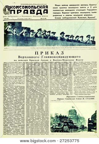 """MOSCOW, USSR - MAY 4: Soviet newspaper """"Komsomolskaya Pravda """" with a photos of Soviet government and big military chief; tanks in Nazi Berlin, on May 4, 1945 in Moscow, USSR"""