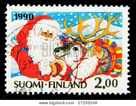 FINLAND - CIRCA 1992: A Christmas stamp printed in Finland shows Santa Claus, circa 1992