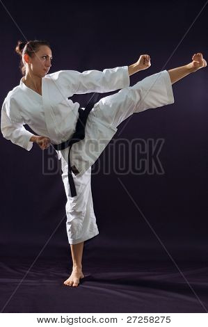 karateka girl on black background studio shot