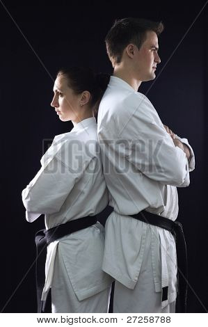 karate couple champions of the world in profile on black background