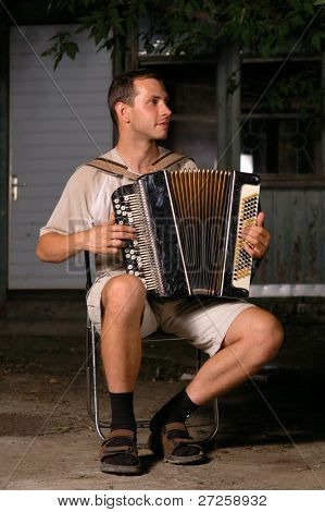 button accordion playing evening serenade outdoor