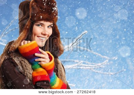 teenager girl pretty smiling on winter snow blue background
