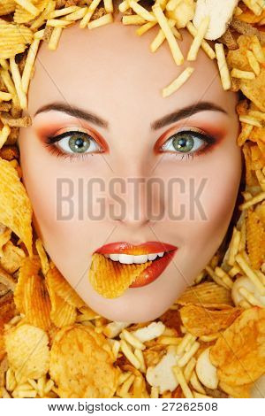 woman beauty face with unhealth eating fast food potato chips rusk frame