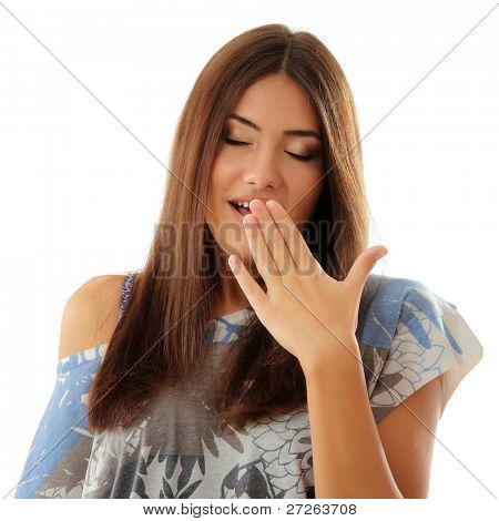 teen girl yawns isolated on white background