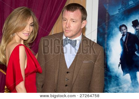 WESTWOOD, CA - DECEMBER 6: Director Guy Ritchie and Jacqui Ainsley arrive at the premiere of