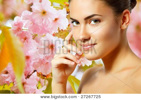 teen girl beautiful cheerful enjoying over spring Japanese cherry tree background