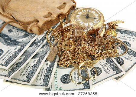 """Cash for gold"" or ""Cash 4 Gold"" a leather pouch filled with gold jewelry lays upon a pile of cash isolated on white with room for your text. represents CASH FOR GOLD  concepts isolated on white"