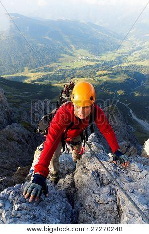 Climbing alpinist