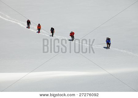 Alpinists crossing a glacier
