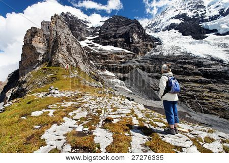 Old woman contemplating Eiger Peak, Berner Oberland, Switzerland - UNESCO Heritage
